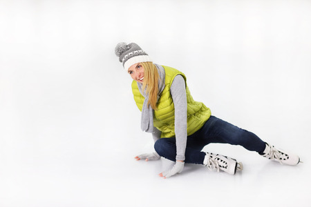 iceskates: A picture of a young woman falling on an ice rink Stock Photo