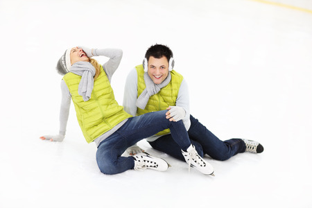 ice rink: A picture of a young couple ice-skating on a rink Stock Photo