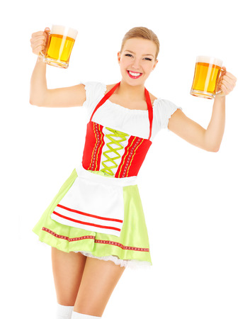 sexy costume: A picture of a beautiful bavarian waitress holding two beer mugs over white background Stock Photo