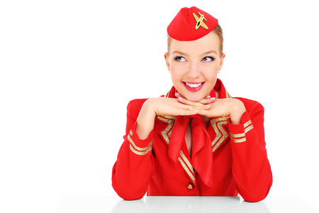 airline hostess: A picture of an attractive stewardess posing over white background