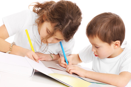 A picture of a young siblings doing homework over white background photo