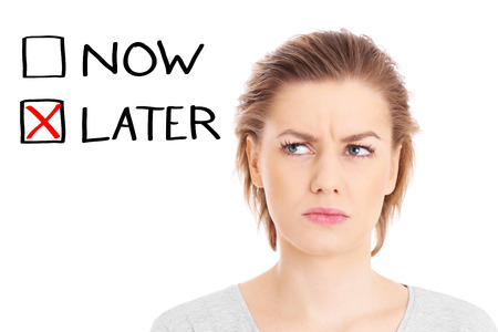 worried woman: A picture of a worried woman posing over white background