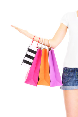 A picture of a woman holding shopping bags over white background photo