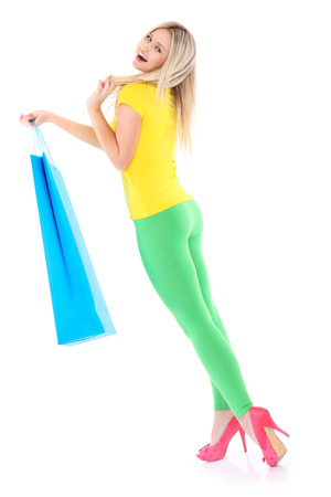 A picture of a beautiful woman carrying a big shopping bag over white background photo