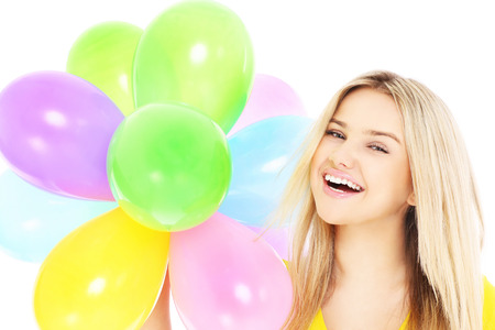 baloons: A picture of a young woman holding baloons over white background