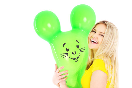 balloon animals: A picture of a young woman holding a bunny balloon over white background Stock Photo