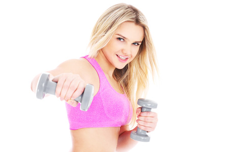 dumbell: A picture of a young pretty woman exercising over white background