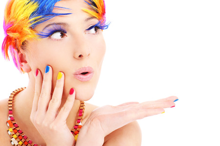 A portrait of a happy woman in a colorful makeup posing over white background Stock Photo