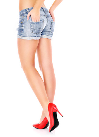Woman in red hills and with long legs