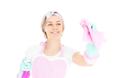 A portrait of a happy housekeeper in retro style posing with a cloth and spray over white background photo