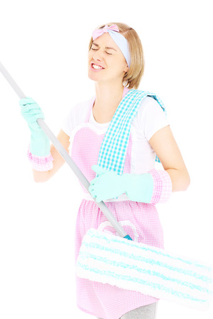 A picture of a happy crazy woman playing with a mop over white background photo