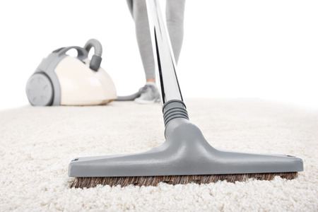 hoover: A picture of a carpet being vacuumed over white background Stock Photo