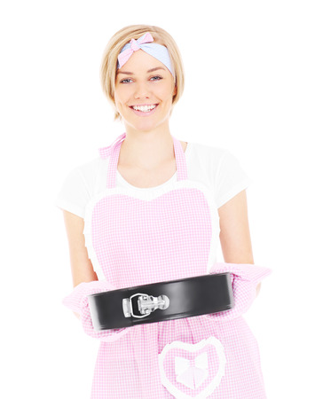 A portrait of a retro style housewife holding a cake tin over white background photo