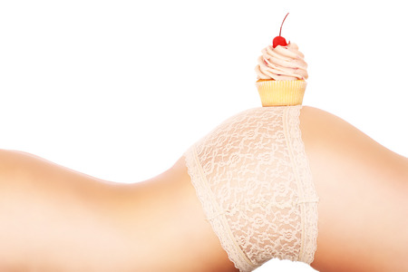 digesting: A picture of a fresh cupcak placed on a sensual female butt