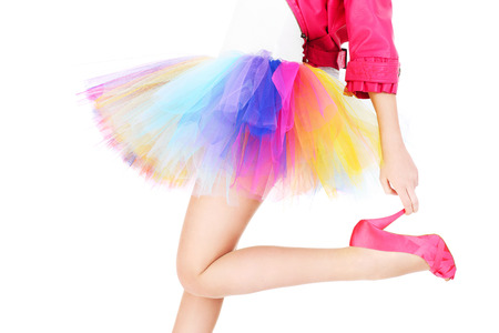 A picture of a woman in a colorful ballerina dress and pink heels posing over white background photo