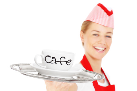 A picture of a happy waitress posing with a serving tray and coffee over white background photo