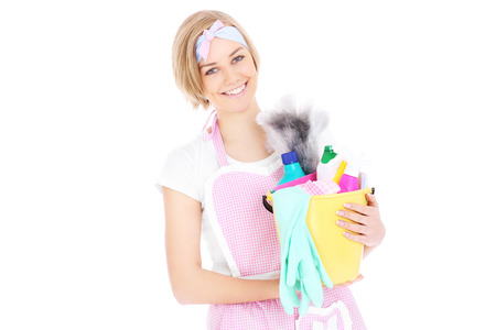 house maid: A picture of a happy woman holding a bucket full of detergents over white background