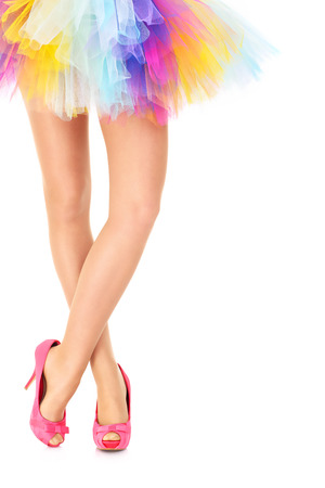 A picture of a sexy woman in a colorful ballerina dress and pink heels posing over white background photo
