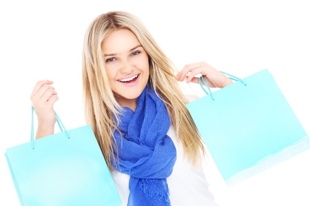 A picture of a beautiful woman carrying shopping bags over white background photo