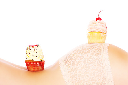 digesting: A picture of two fresh cupcakes placed on a sensual female back