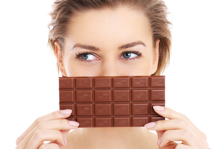 A picture of a pretty woman holding chocolate over white
