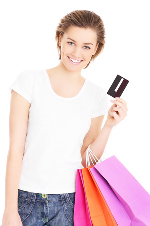 A picture of a beautiful woman shopping with a credit card over white background photo
