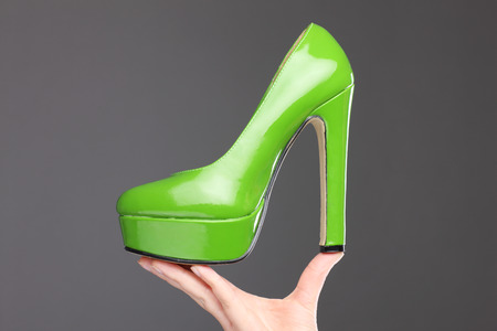 high heeled shoe: A picture of a green high heeled shoe presented over gray background Stock Photo