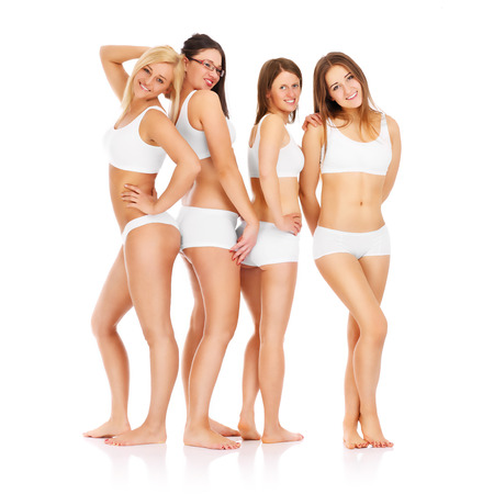 A picture of four girl friends posing in underwear over white background photo