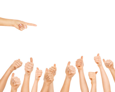 thumbs up group: A picture of team of people showing ok signs and pointing over white background