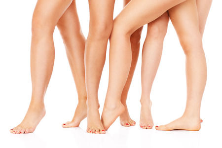 long feet: A picture of female legs over white background