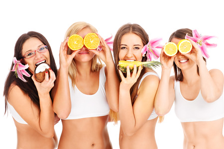 Group of young girls with fruits