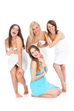 women in underwear: A picture of four girl friends chatting in towels over white background