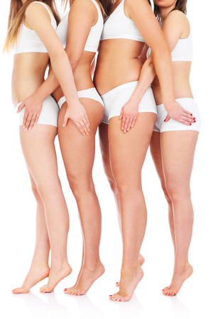 A picture of four female bodys over white background Stock Photo