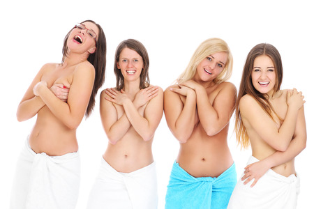 a group of young topless women in towels Stock Photo