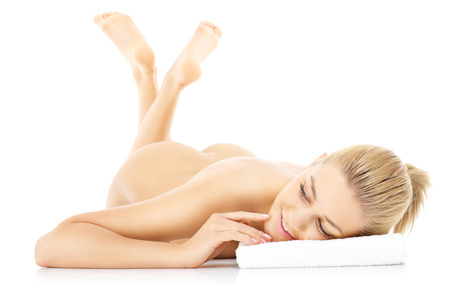 A picture of a sensual naked woman lying over white background photo