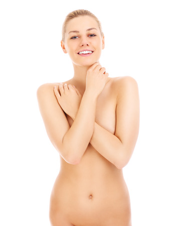 Beautiful young nude woman over white background photo