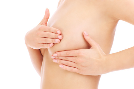 Woman and hand breast test over white background photo