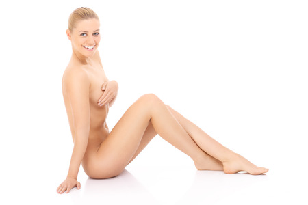 nude blonde girl: Nice and happy young sitting woman over white background Stock Photo