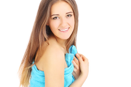 Young nice girl in blue towel over white background photo