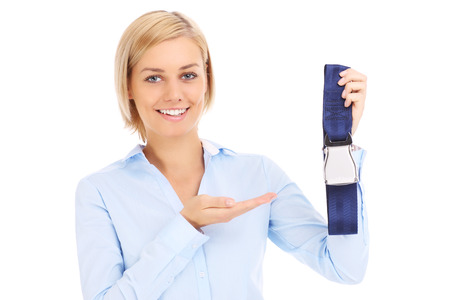 an attendant: Blonde stewardess in blue shirt showing belt over white Stock Photo