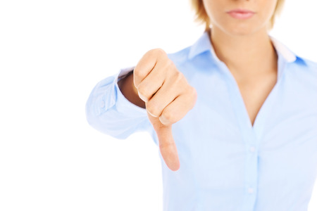 Woman showing negative sign over white background