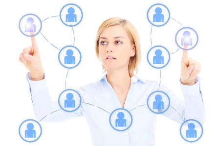 referrals: Young businesswoman and social network over white background