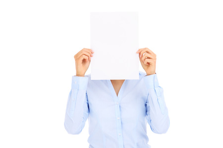Businesswoman holding blank paper over white background photo