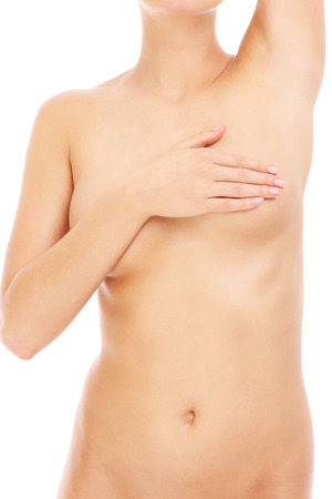 A picture of a naked woman checking her breast over white background photo