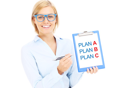 dilema: A picture of a young businesswoman with plan A and plan B over white background Stock Photo