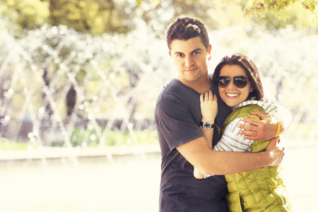 lovely couple: A picture of a lovely couple hugging in the park Stock Photo