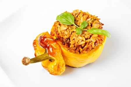 bell peppers: A picture of a yellow stuffed pepper baked and served on a white plate