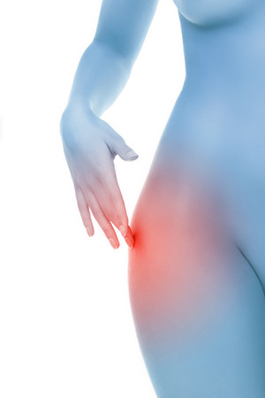 Midsection of female body with hip pain over white background photo