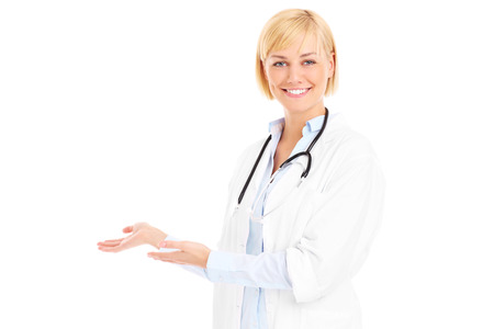 A picture of a young doctor with stethoscope welcoming you over white background photo
