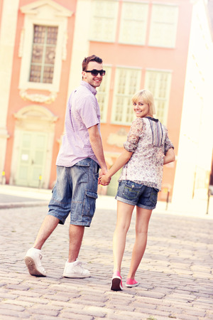 strolling: A picture of a happy couple strolling about the city Stock Photo